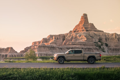 Toyota Tacoma Quicksand Tan TRD Offroad 2018 side shot driving down road in the Badlands National Park South Dakota