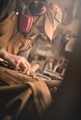 Tom Dean of Milo Creek Carvings working on the details of the RMEF world elk calling championships trophy