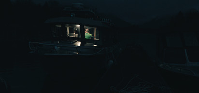 RED Raven 4.5k frame grab of the Homathko camp boat dock with a jet boat on one side, pilothouse boat on the other