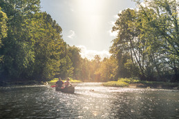 Father and son Jon B. Fishing the Midwest paddle down stream on a river in Ohio in an old Canoe while on a fishing trip