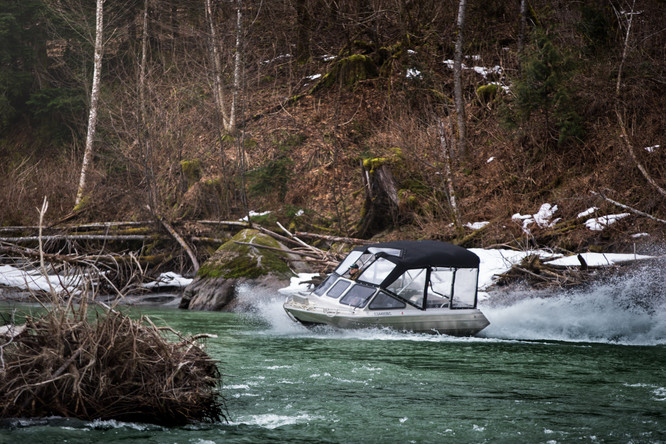 firefish piranha jet boat navigating river in coastal British Columbia white water boats mecury sport jet inboard