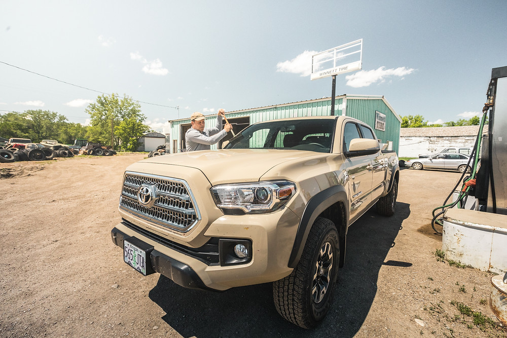 Toyota Tacoma TRD Offroad Tan fueling up in Winnett Montana
