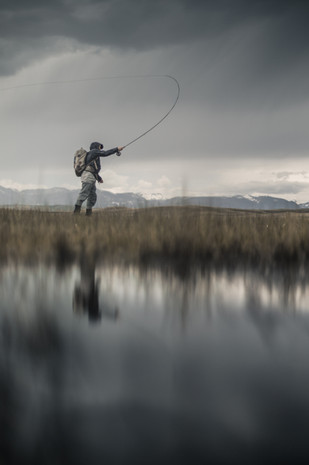 Fly fisherman Double Hauling for pike in Montana