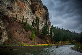 Canoe paddler navagates low river conditions while on fall float of Montana's Smith River