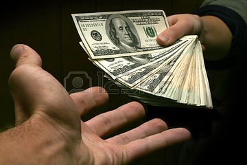2189715-a-stack-of-cash-being-handed-over-from-one-hand-to-another.jpg