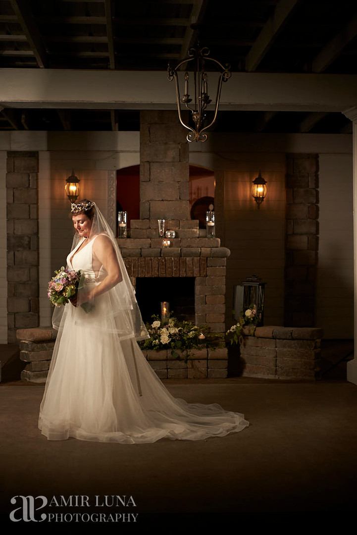 Night time bride by fireplace at Chateau Vie