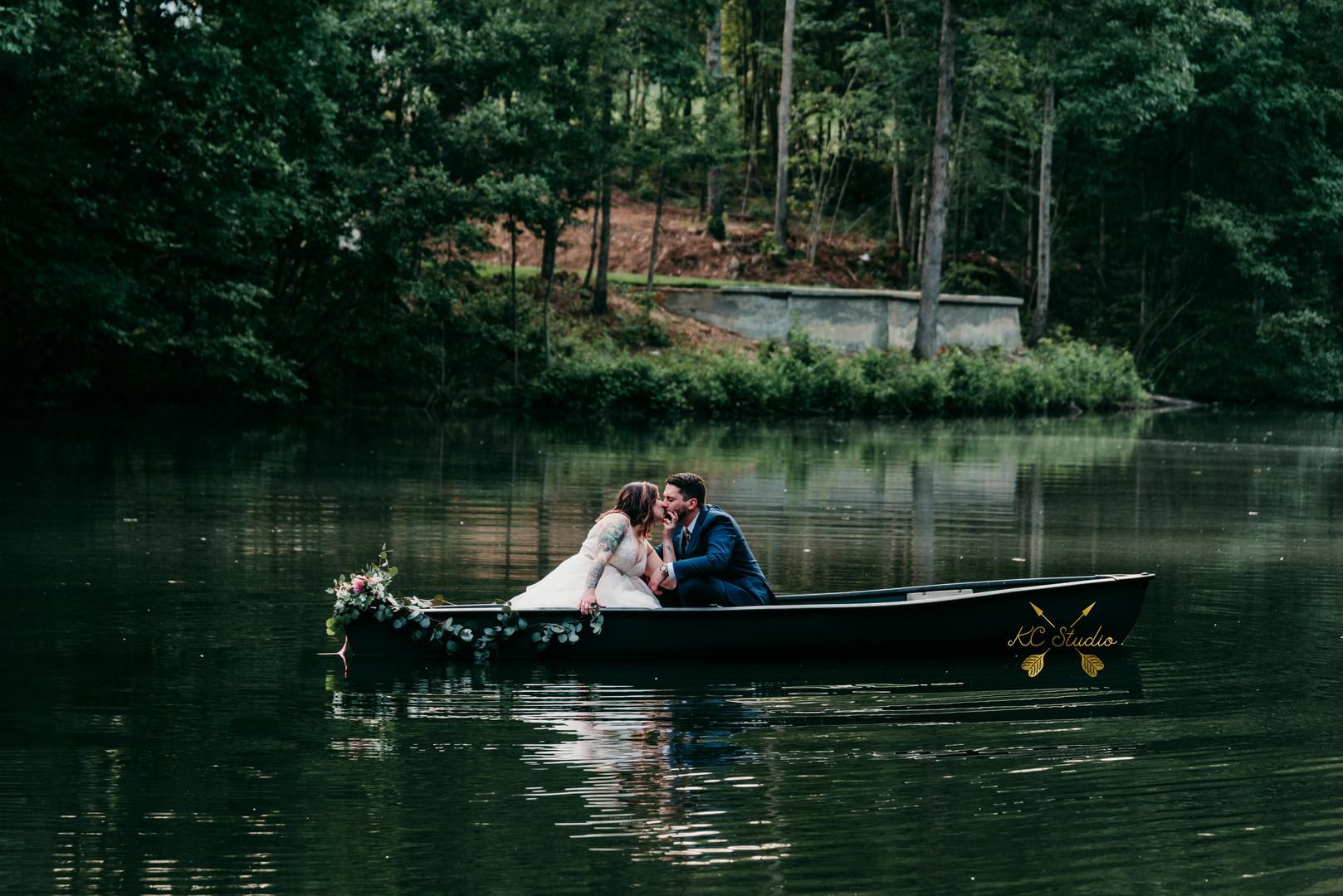 Bride & Groom in Canoe, Lake, Chateau Vi