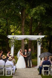 Christie & Nick Ceremony in Garden.jpg