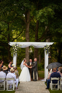 Christie & Nick Ceremony in Garden.jpg