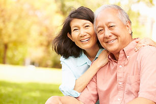 Portrait Of Senior Asian Couple Sitting