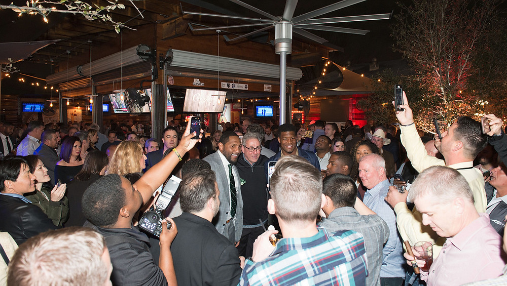 NFL legends posing for pictures at Ditka and Jaws party