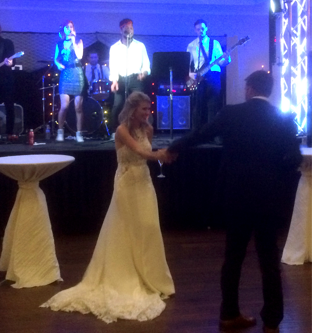 Bride and groom with The After Party band