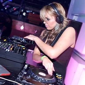 DJ Genafire spinning records at a gig