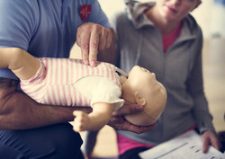 bigstock-CPR-First-Aid-Training-Concept-168440921