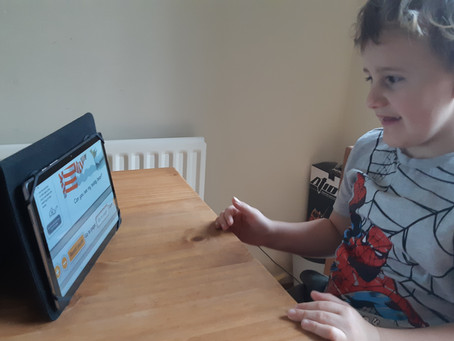 Harley in 1TM enjoys reading his books on oxford owl. Well done!