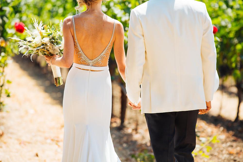 Bride & Groom walking in the vineyard