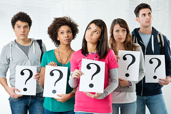 group_of_students_holding_question_mark_