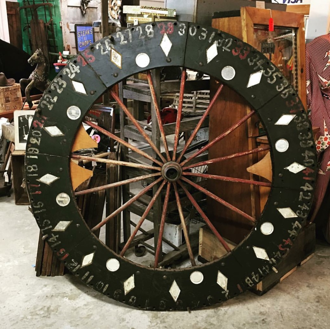 antique_wood_wagon_wheel_spin_casino_game_spinning_gypsy_poker_gambling_western_folk_art_roulette_go