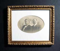 Formal framing of original B&W portrait