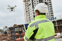 Drone operated by construction worker on
