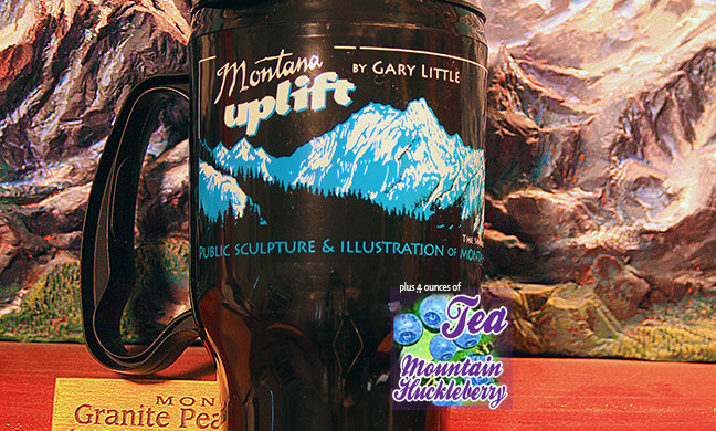 Thermal gift mug with mountain huckleberry tea left side
