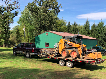 Trailer ready to haul materials from old barn property