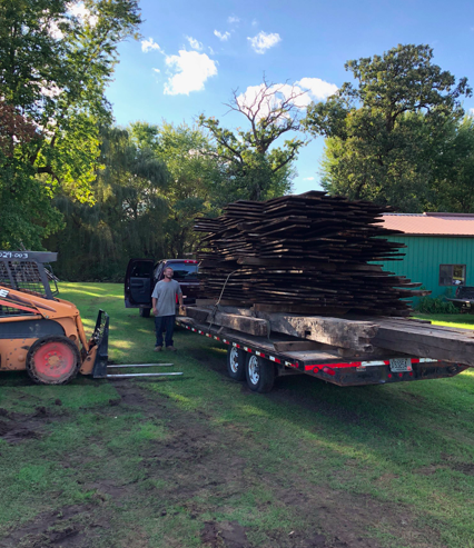 Trailer loaded with barn beams
