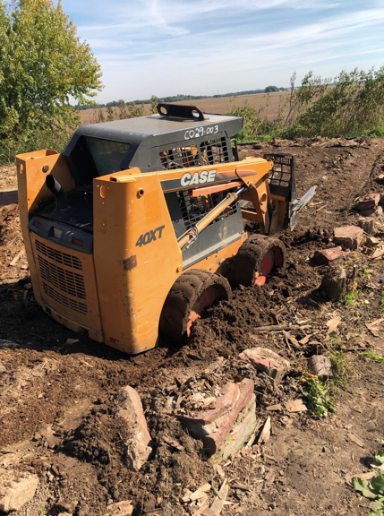 Wisconsin skid loader stuck in the mud after months of heavy rain