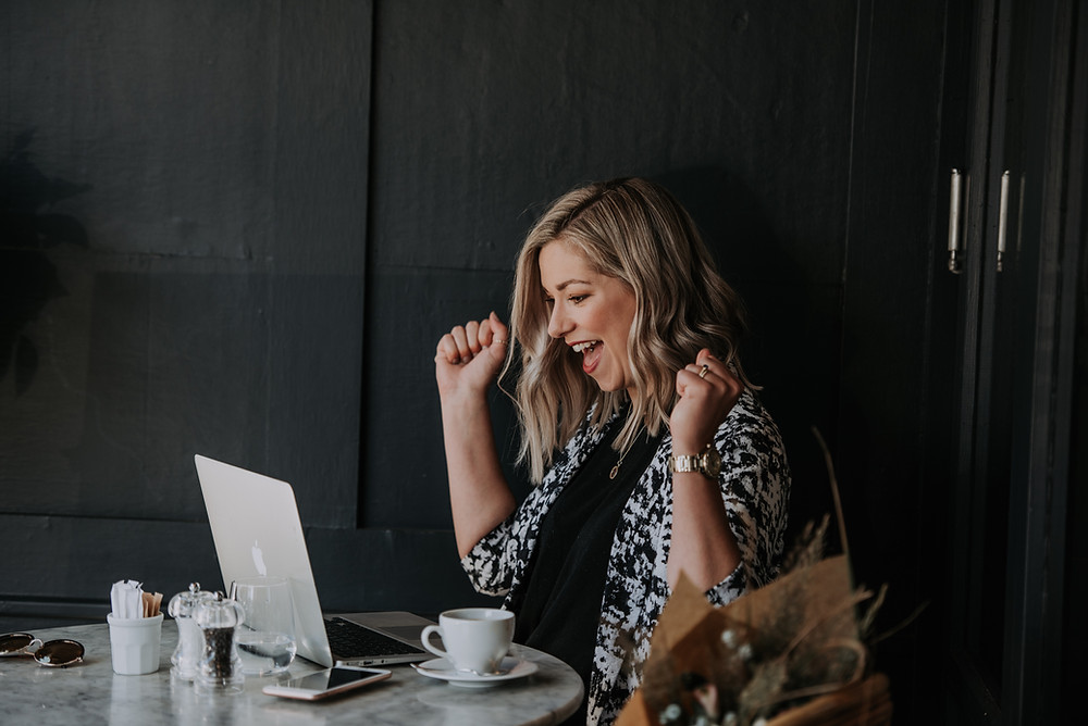 Lady entrepreneur happy looking at computer