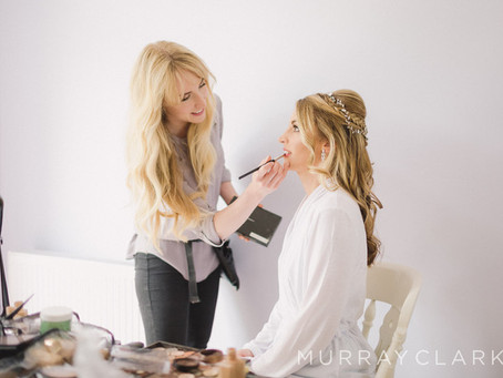 Should I book a hair and makeup artist for my wedding day?