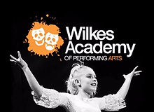 Girl performing on stage with the Wilkes Academy