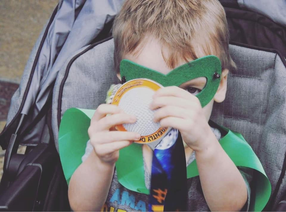 Flynn with his finisher medal.
