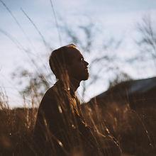 Canva - Silhouette of Man Sitting on Gra