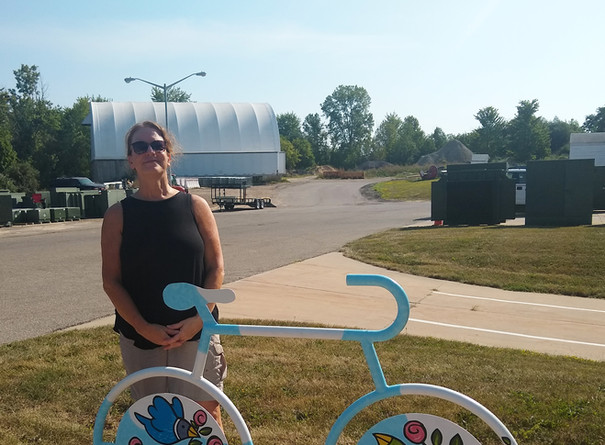Carolyn Fink with Completed Mural Bike Rack