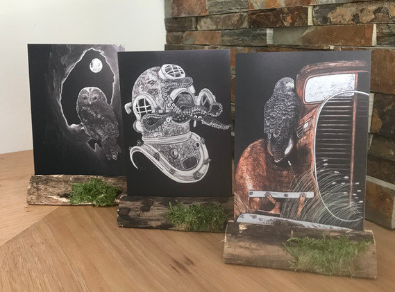 2D metal images in a wooden decorative stand, frame or cradle by Chandra Jennings