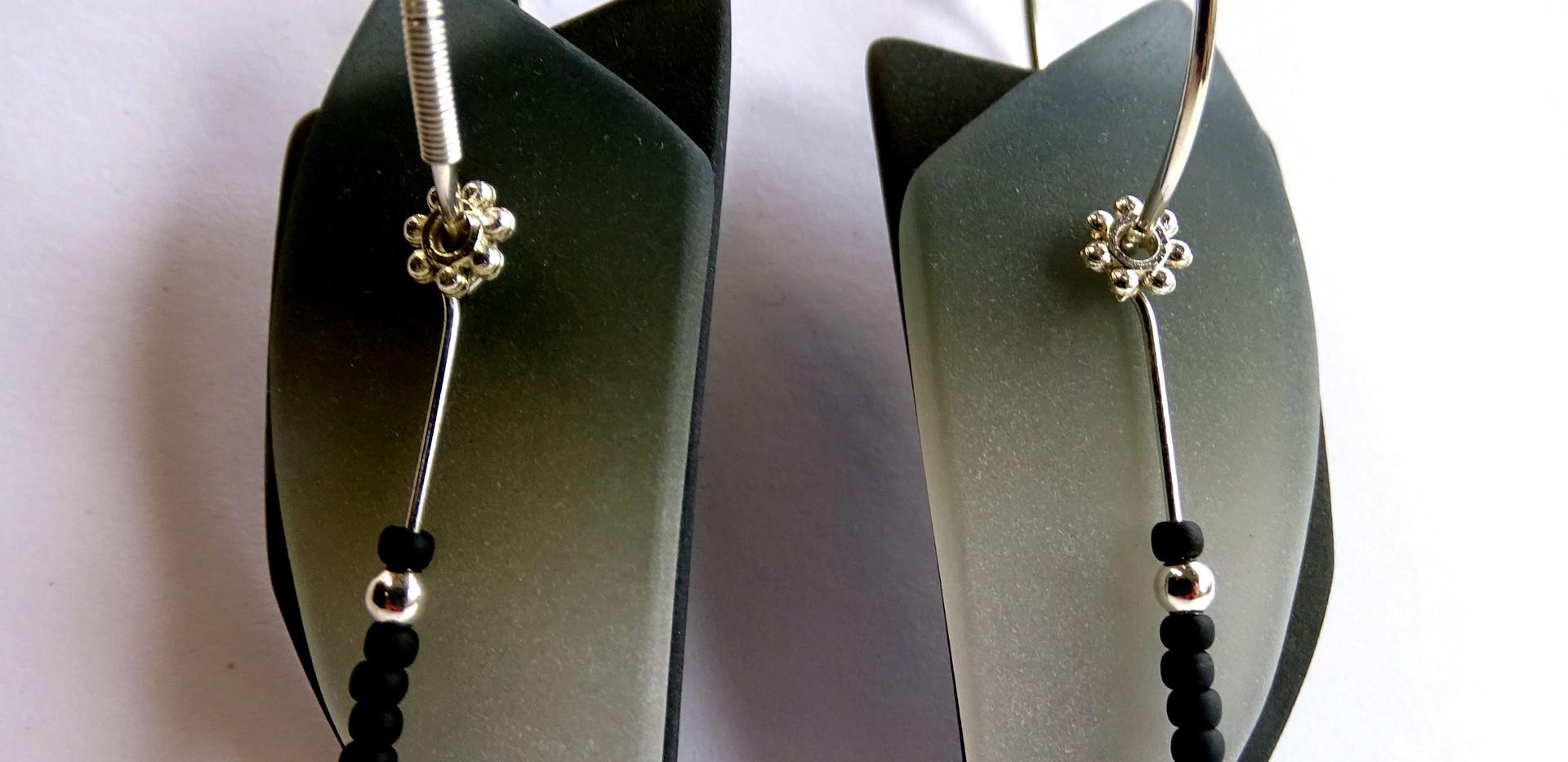 Hoops black and white earrings by Maggie Joyce