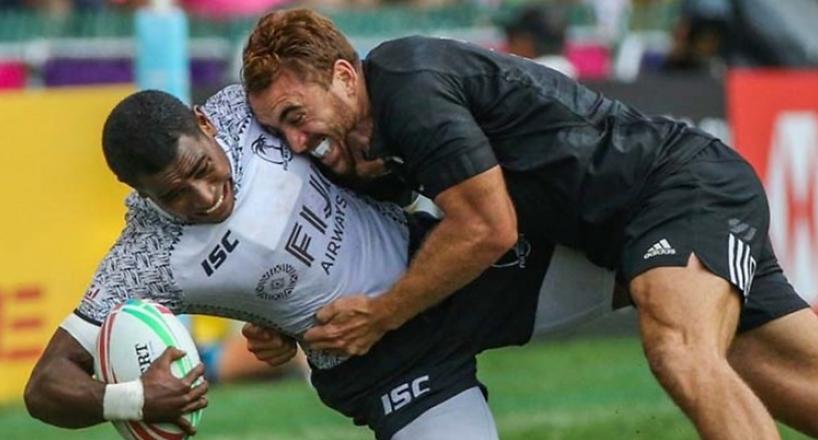 Fiji Airways Fijian 7s winger Aminiasi Tuimaba is tackled by Joe Webber of New Zealand during last y