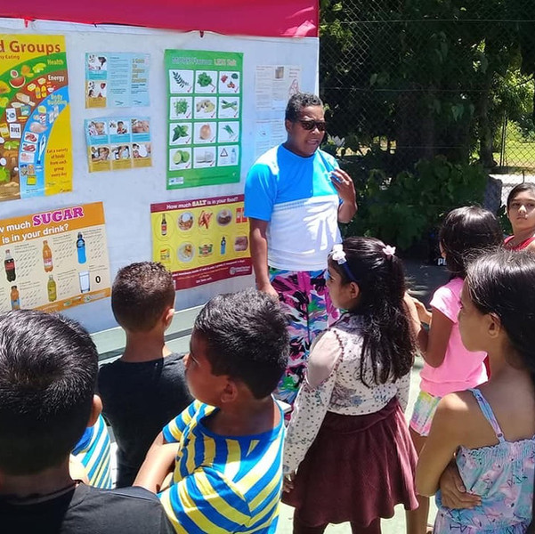 Development officer Lala delivers a lesson on health and nutrition
