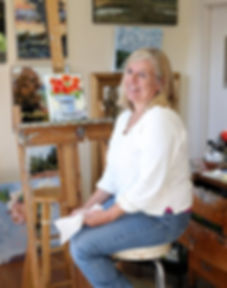 Artist Lorrie Lane in her studio painting