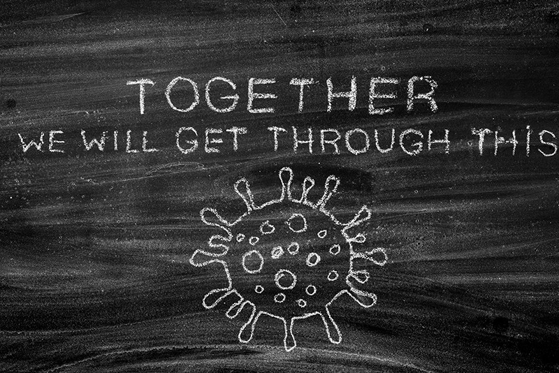 Chalk drawing saying that together we will get through this