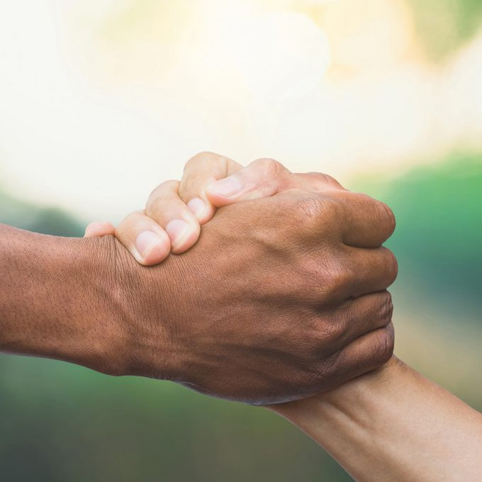 Hands holding each other in a supportive way.