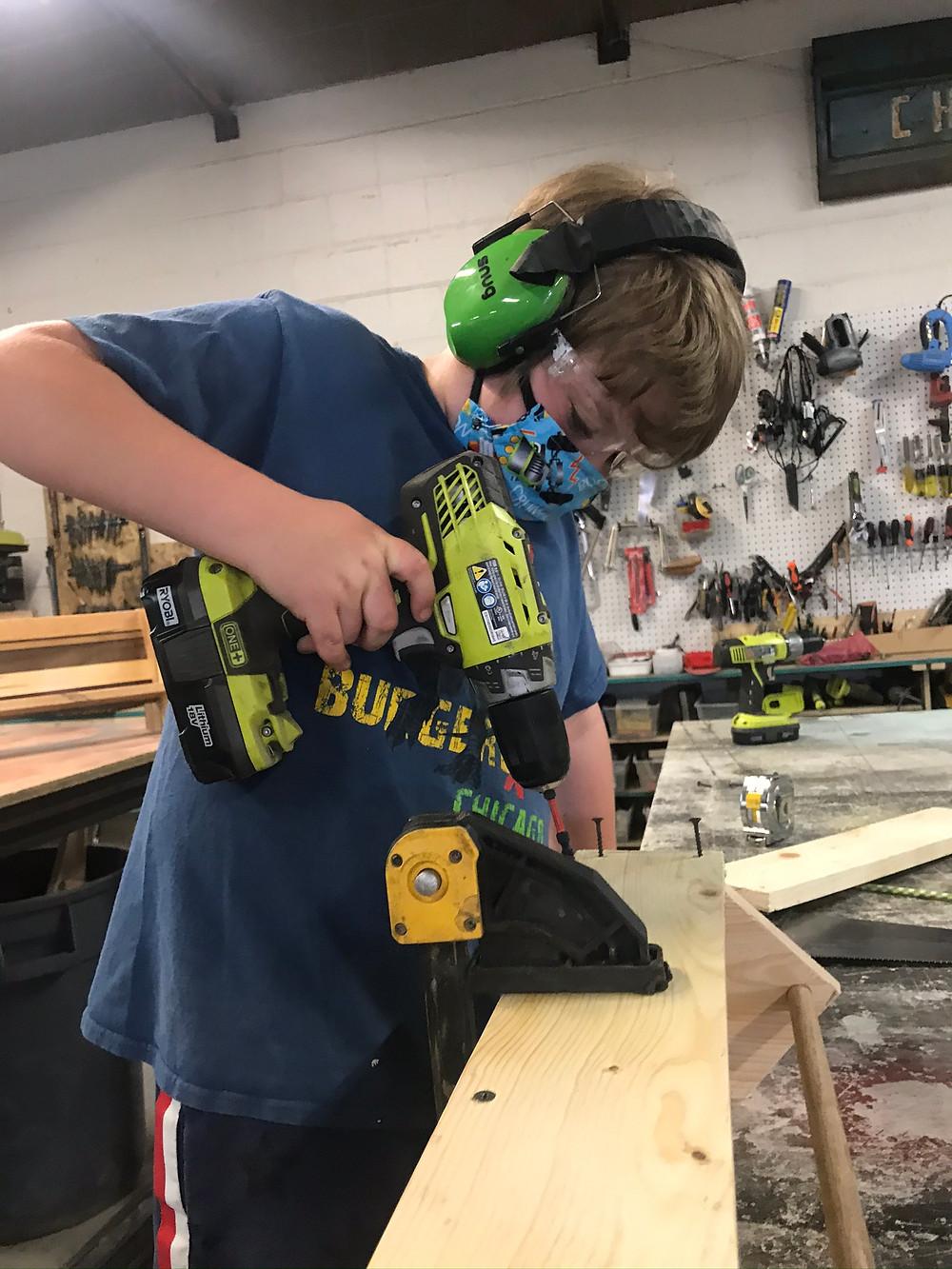 Boy working in a wood shop