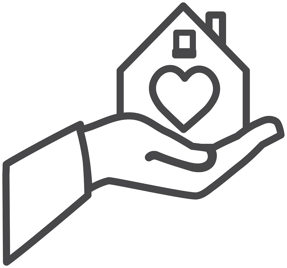 Mano sosteniendo una casa