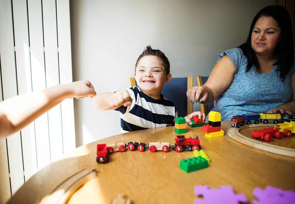 Young boy with Down syndrome with his mother