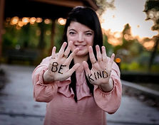 "Photo of Rena Rosen with ""Be Kind"" Written on her hands"