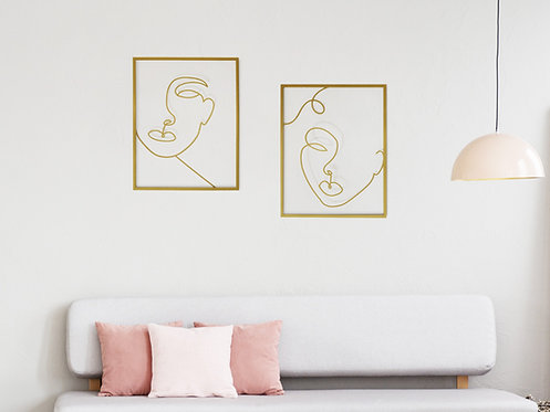 gold metal wall art of faces