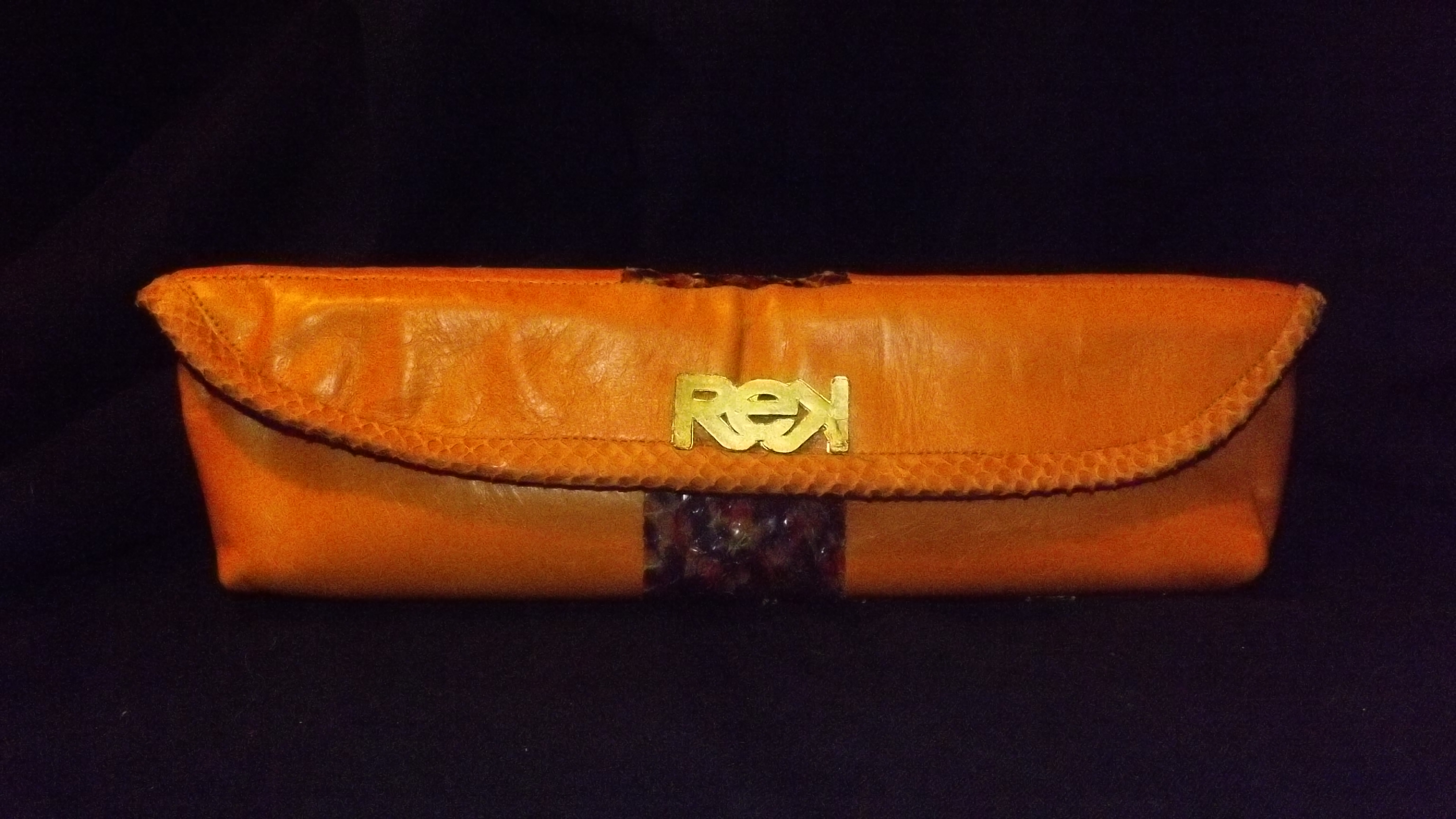 vintage orange and python clutch