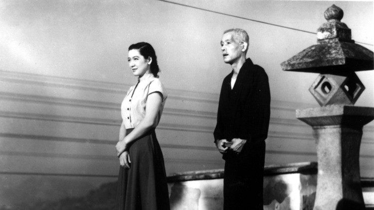 Father and daughter looking at the view together. Taken from the film Tokyo Story, by Yasujiro Ozu.