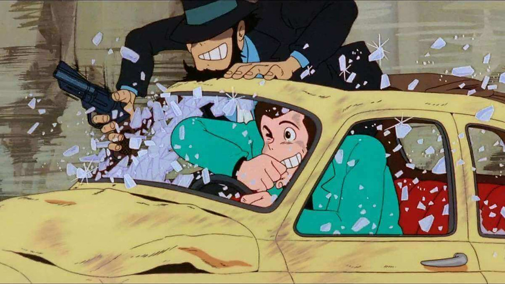 Lupin the Third and Jigen smashing the window of their car while driving. Taken from the anime «The Castle of Cagliostro».
