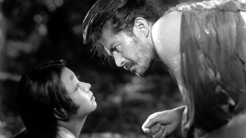 Toshiro Mifune in the Japanese film Rashomon (1950). Mifune is looking hard into the eyes of his female co-star.